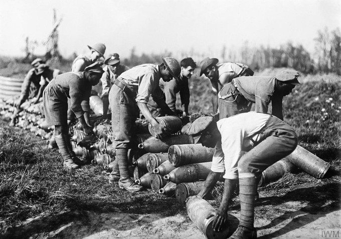 West Indian troops stacking 8 inch shells at a dump on the Gordon Road, Ypres, October 1917. © IWM (E(AUS) 2078)